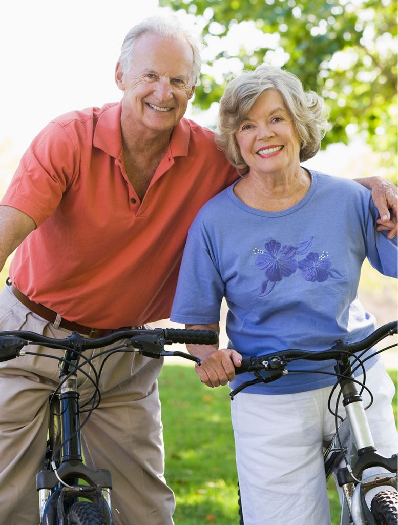 Healthy Elderly Couple on Bicycles